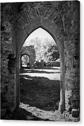 Arched Door At Ballybeg Priory In Buttevant Ireland Canvas Print by Teresa Mucha