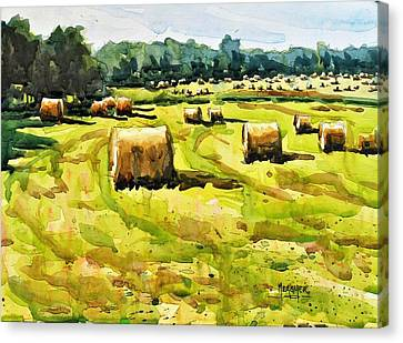Army Of Hay Bales Canvas Print by Spencer Meagher
