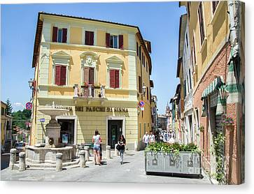 Asciano, People Stroll In The Small Square Canvas Print by Luca Lorenzelli