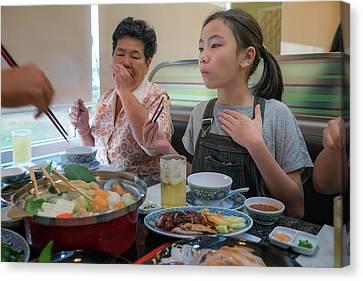 Asian Family Party With Shaby Sukiyaki Set Manu In Restaurant Canvas Print by Anek Suwannaphoom