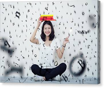 Character Study Canvas Print - Asian Lady Sitting With A Book And Rain Of Alphabet by Anek Suwannaphoom