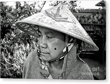 Asian Woman With A Mole On Her Cheek And Wearing A Conical Hat  Canvas Print by Jim Fitzpatrick