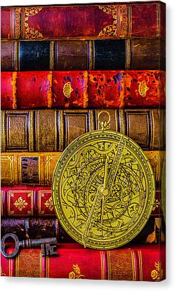 Astrolabe And Old Books Canvas Print by Garry Gay