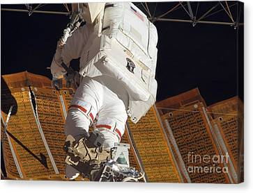 Astronaut Installs Stabilizers Canvas Print by Stocktrek Images