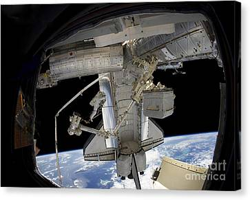 Component Canvas Print - Astronaut Participates In A Spacewalk by Stocktrek Images