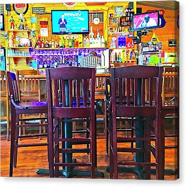 At The Bar Canvas Print by Susan Leggett