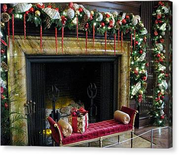 At The Hearth Of Christmas Canvas Print by Angela Davies