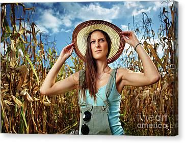 Attractive Woman Farmer In The Cornfield Canvas Print by Catalin Petolea