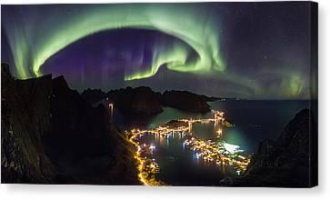 Aurora Above Reine Canvas Print by Alex Conu