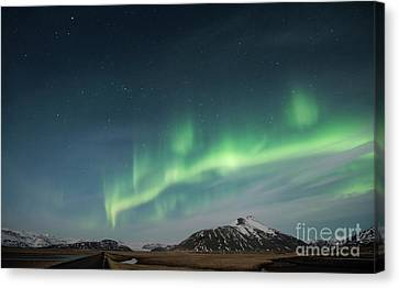 Canvas Print featuring the photograph Aurora Borealis Over Iceland by Sandra Bronstein