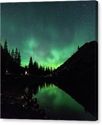 Aurora On Moraine Lake Canvas Print by Alex Lapidus