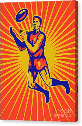 Aussie Rules Player Jumping Ball Canvas Print by Aloysius Patrimonio