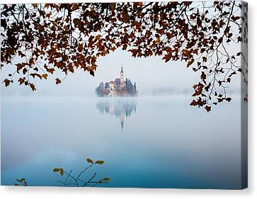 Autumn Mist Over Lake Bled Canvas Print by Ian Middleton