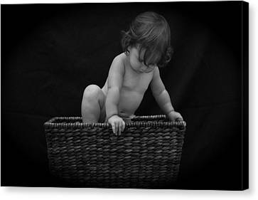 Canvas Print featuring the photograph Baby In A Basket by Michael Albright