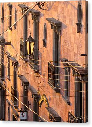 Balconies And Wires At Sunset. Canvas Print by Rob Huntley