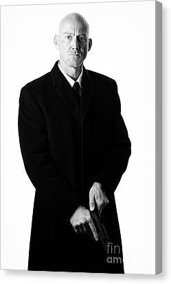 Bald Headed Man Wearing Heavy Black Overcoat Cocking Automatic Handgun Canvas Print by Joe Fox