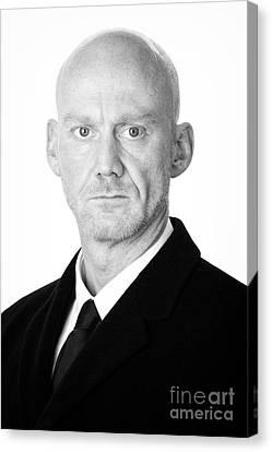 Bald Headed Man Wearing Heavy Black Overcoat Canvas Print by Joe Fox