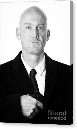 Bald Headed Man Wearing Heavy Black Overcoat Pulling Handgun Out Of Pocket  Canvas Print by Joe Fox