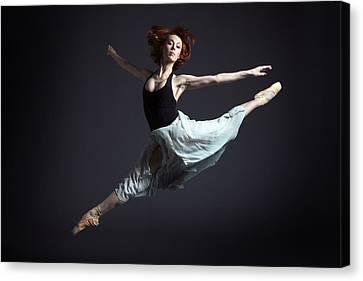 Ballerina In Flying Pose Canvas Print by Artur Bogacki