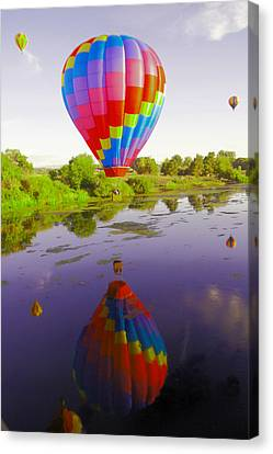 Balloon Reflecting In The Water Canvas Print by Jeff Swan