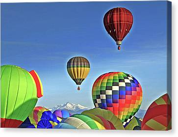 Ballooning Above Longs Peak Canvas Print by Scott Mahon