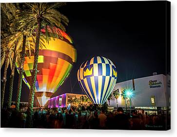 Balloons In The City Canvas Print by Marvin Spates