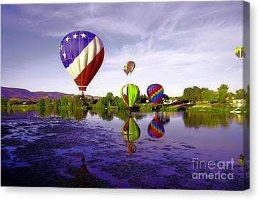 Balloons In The Yakima River Canvas Print by Jeff Swan