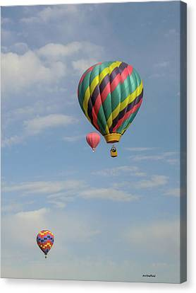 Balloons Over The Desert Canvas Print by Allen Sheffield