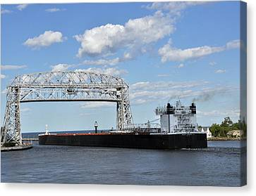 Barge Crossing Canvas Print by John Ricker