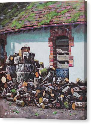 Barn With Log Pile Canvas Print by Martin Davey