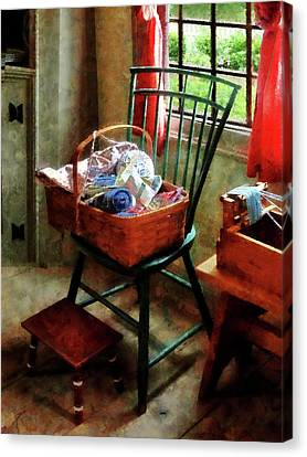 Basket Of Cloth And Yarn On Chair Canvas Print by Susan Savad