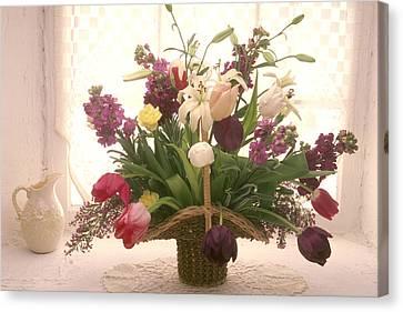 Basket Of Flowers In Window Canvas Print by Garry Gay