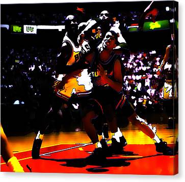 Battle In The Paint Canvas Print by Brian Reaves