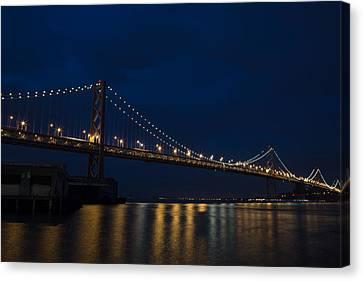 Bay Bridge At Night Canvas Print by John Daly