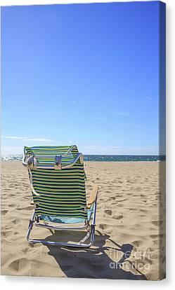 Sandy Beach Canvas Print - Beach Chair On A Sandy Beach by Edward Fielding