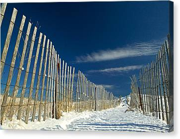 Beach Fence And Snow Canvas Print by Matt Suess