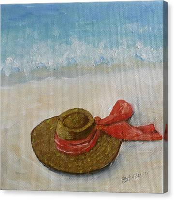 Beach Hat In The Sand Canvas Print by Barbara Harper