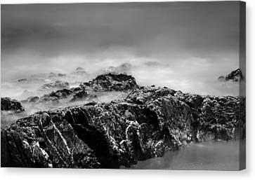 Beach Rocks And Surf In Mono Canvas Print by Georgia Fowler
