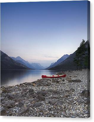 Beached Canoe Awaits Nightfall Canvas Print by Royce Howland