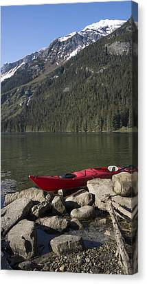 Beached Kayak In Alaska Canvas Print by Michele Cornelius