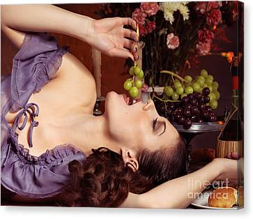 Beautiful Woman Eating Grapes On A Festive Table Canvas Print by Oleksiy Maksymenko