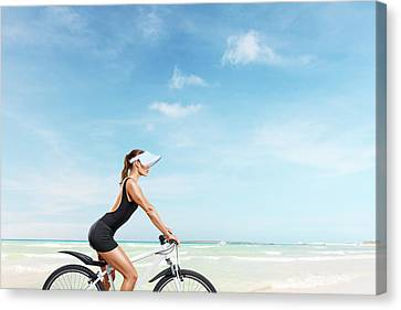 Beautiful Woman On Bicycle Canvas Print by IPolyPhoto Art