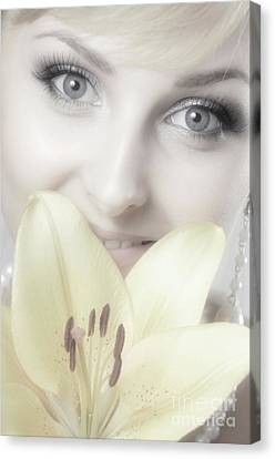 Beautiful Young Woman With A Yellow Lily Canvas Print by Oleksiy Maksymenko
