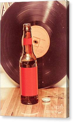 Beer Bottle On Bar Counter Top With Vinyl Record Canvas Print