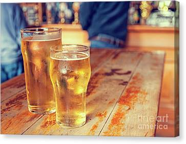 Canvas Print featuring the photograph Beers In A Pub by Patricia Hofmeester