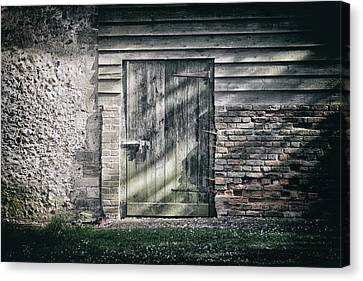 Behind The Door Canvas Print by Martin Newman