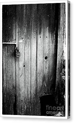 Behind The Locked Door Canvas Print by John Rizzuto