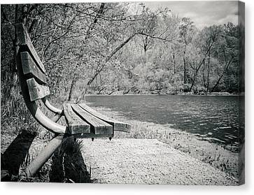 Bench By The Water Canvas Print by Amy Turner
