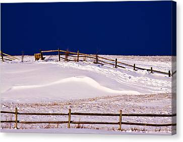 Canvas Print featuring the photograph Bench On A Winter Hill by Don Nieman