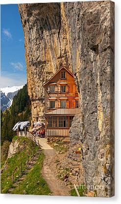 Berggasthaus Aescher Wildkirchli Canvas Print by Caroline Pirskanen